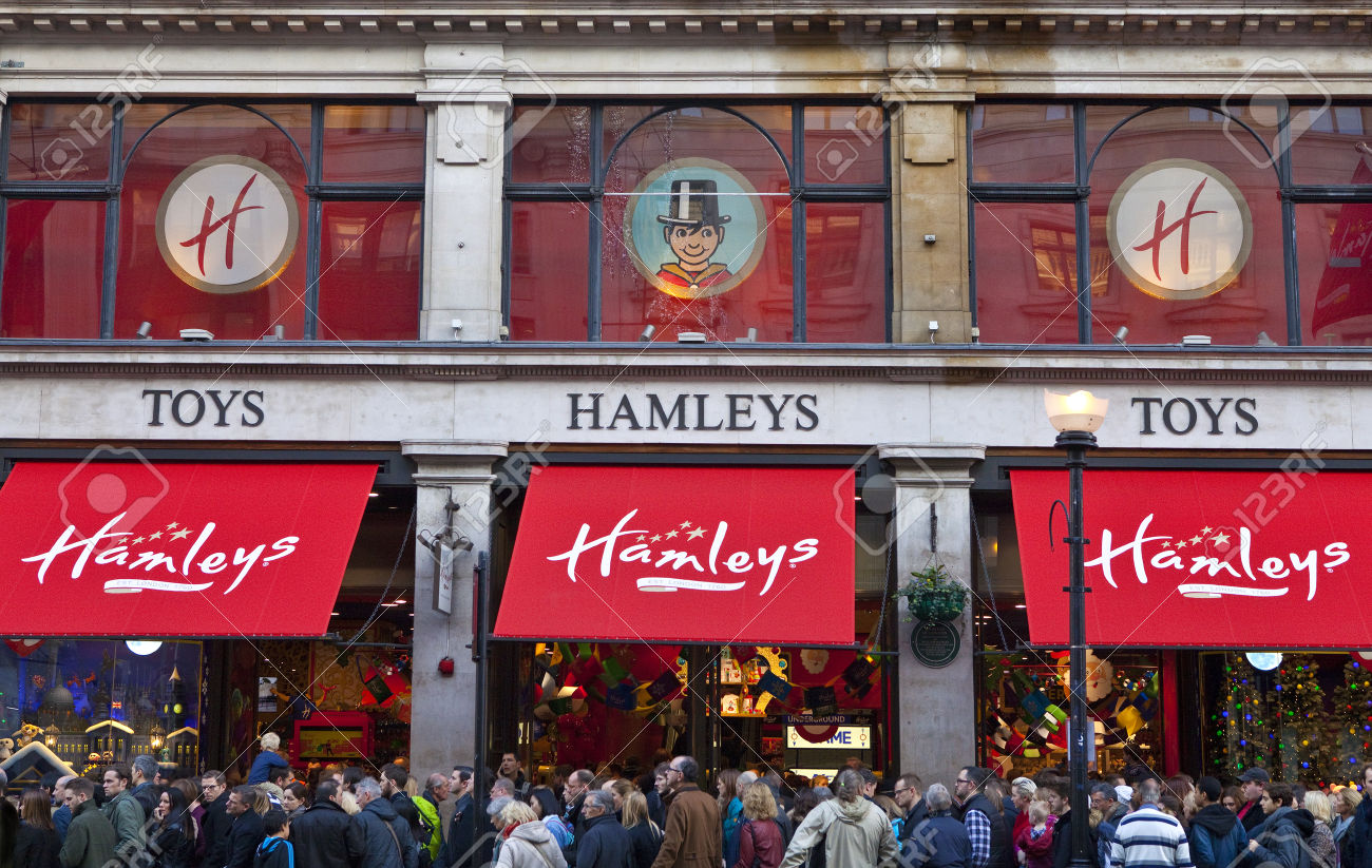 LONDON, UK - NOVEMBER 29TH 2014: Crowds of shoppers flood past and into Hamleys Toy Shop on Regent Street in London, on 29th November 2014.  Founded in 1760, Hamleys is the oldest toy shop in the world and one of the world's most famous retailers of toys.